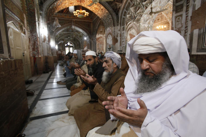 Pakistani worshippers attend a Friday prayers in Peshawar, Pakistan, Friday, March 27, 2020. Authorities imposed nation-wide lockdown and appealed to people to avoid public gatherings as a preventive measure to contain the spread of coronavirus. The virus causes mild or moderate symptoms for most people, but for some, especially older adults and people with existing health problems, it can cause more severe illness or death.(AP Photo/Muhammad Sajjad)