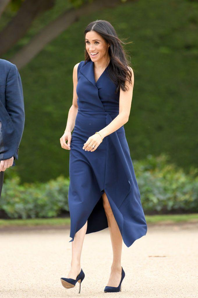 """<p>Harry and Meghan visited Melbourne on day three of their royal tour. For a walkabout and reception hosted at Government House, <a href=""""https://www.townandcountrymag.com/style/fashion-trends/a23878629/meghan-markle-dress-melbourne-australia-royal-tour/"""" rel=""""nofollow noopener"""" target=""""_blank"""" data-ylk=""""slk:the Duchess wore a navy dress"""" class=""""link rapid-noclick-resp"""">the Duchess wore a navy dress</a> by Dion Lee with a pair of pumps.</p>"""