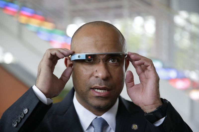 Haiti's Prime Minister Laurent Lamothe wears Google Glass during a demonstration and tour at the Google headquarters complex Wednesday, Nov. 20, 2013, in Mountain View, Calif. From Google to Facebook to Apple, Lamothe plans to spend Wednesday on a whirlwind tour through Silicon Valley's most elite tech campuses, hoping to convince some of the world's wealthiest and most successful corporate executives to share support and innovation with the poorest country in the Americas. Lamothe joins a growing stream of politicians, celebrities and CEOS taking these popular roadshows where they do a little business, a little schmoozing and quite a bit of questioning about how innovation happens in this booming tech region. (AP Photo/Eric Risberg)