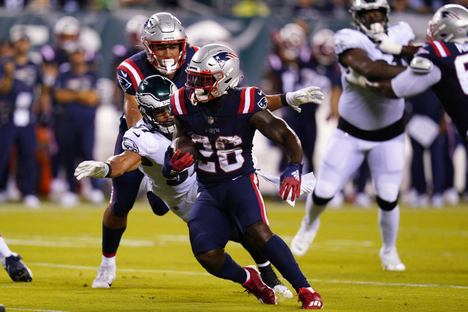 New England Patriots' Sony Michel runs with the ball as Philadelphia Eagles' T.J. Edwards tries to bring him down during the first half of a preseason NFL football game Thursday, Aug. 19, 2021, in Philadelphia. (AP Photo/Chris Szagola)