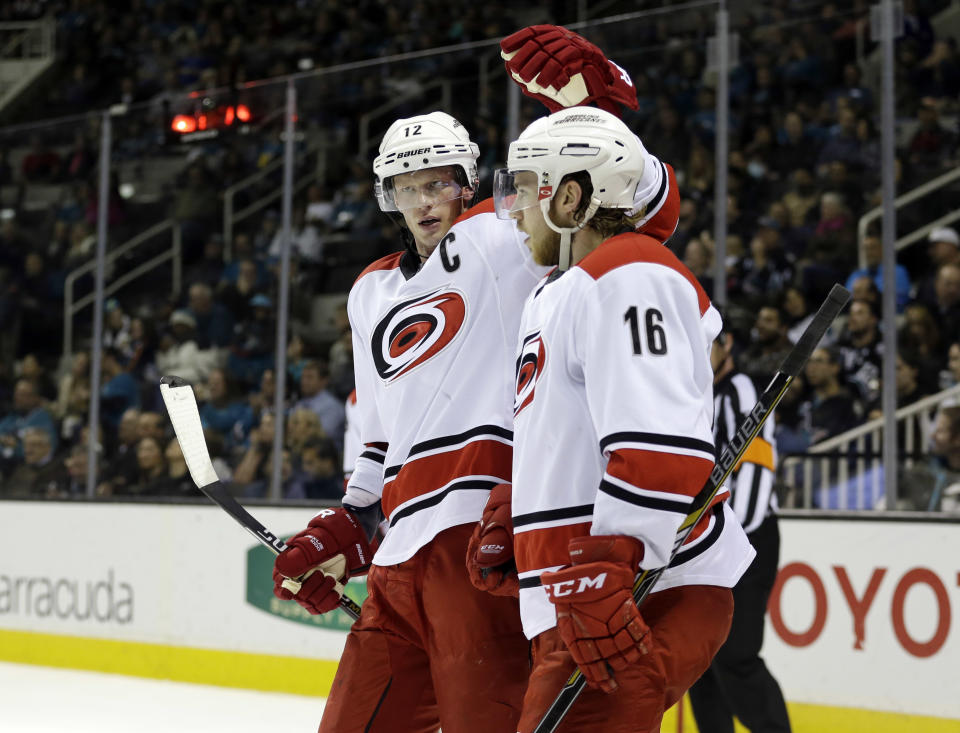 Carolina Hurricanes' Elias Lindholm (16) celebrates his goal with teammate Eric Staal during the second period of an NHL hockey game against the San Jose Sharks on Saturday, Feb. 7, 2015, in San Jose, Calif. (AP Photo/Marcio Jose Sanchez)