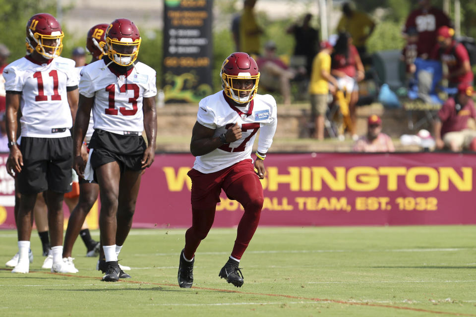 Washington Football Team wide receiver Terry McLaurin (17) runs a route during NFL football practice in Richmond, Va., Wednesday, July 28, 2021. (AP Photo/Ryan M. Kelly)