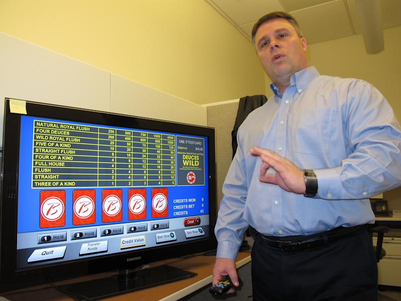 John Forelli, a vice presicent at the Borgata Hotel Casino & Spa in Atlantic City NJ demonstrates a new in-room gambling system Monday Feb. 11, 2013 in Atlantic City. The system will be available to guests starting Feb. 18. The casino says it is the first in the nation to offer this technology, which is says can be expanded to encompass hand-held gambling devices and even Internet betting once it is legalized. (AP Photo/Wayne Parry)