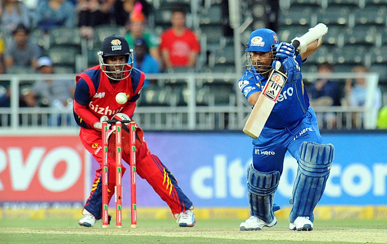 Mumbai Indians batsman Sachin Tendulkar  is almost caught by Highveld Lions wicket keeper Thami Tsolekile   during Group B  Match of The Champions League T20 (CLT20)  at Wanderers Stadium in Johannesburg on October 14, 2012. AFP PHOTO / ALEXANDER JOE