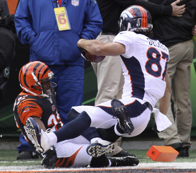 Denver Broncos wide receiver Eric Decker (87) scores on a 13-yard pass reception against Cincinnati Bengals strong safety Nate Clements (22) in the first half of an NFL football game, Sunday, Nov. 4, 2012, in Cincinnati. (AP Photo/Tom Uhlman)