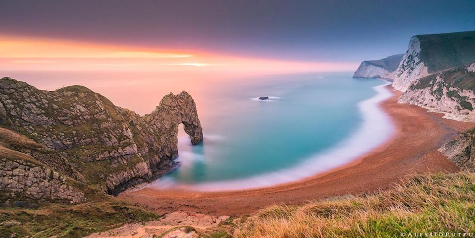 <p>This dreamy image of Durdle-Door, Dorset captures its iconic arch surrounded by the vivid colours of the sunset-filled sky and the creamy blue sea. (Image: Alessio Putzu)<br></p>