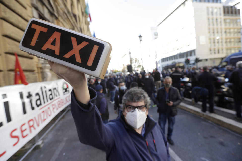 Taxi drivers stage a protest against limitations and the curfew imposed by the government in the effort to curb COVID-19 spread, in Rome Friday, Nov. 6, 2020. (AP Photo/Andrew Medichini)