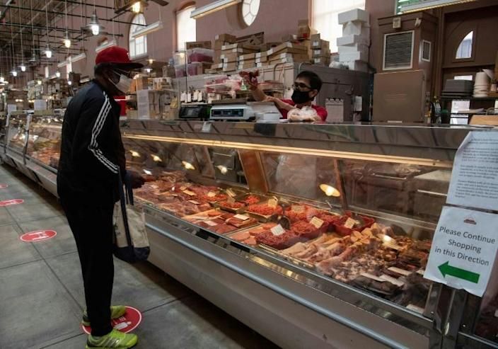 A man purchases meat at in Washington, DC, on May 5, 2020. US slaughterhouses have emerged as COVID-19 outbreak hotspots in several states, providing a window of opportunity for plant-based protein (AFP Photo/NICHOLAS KAMM)