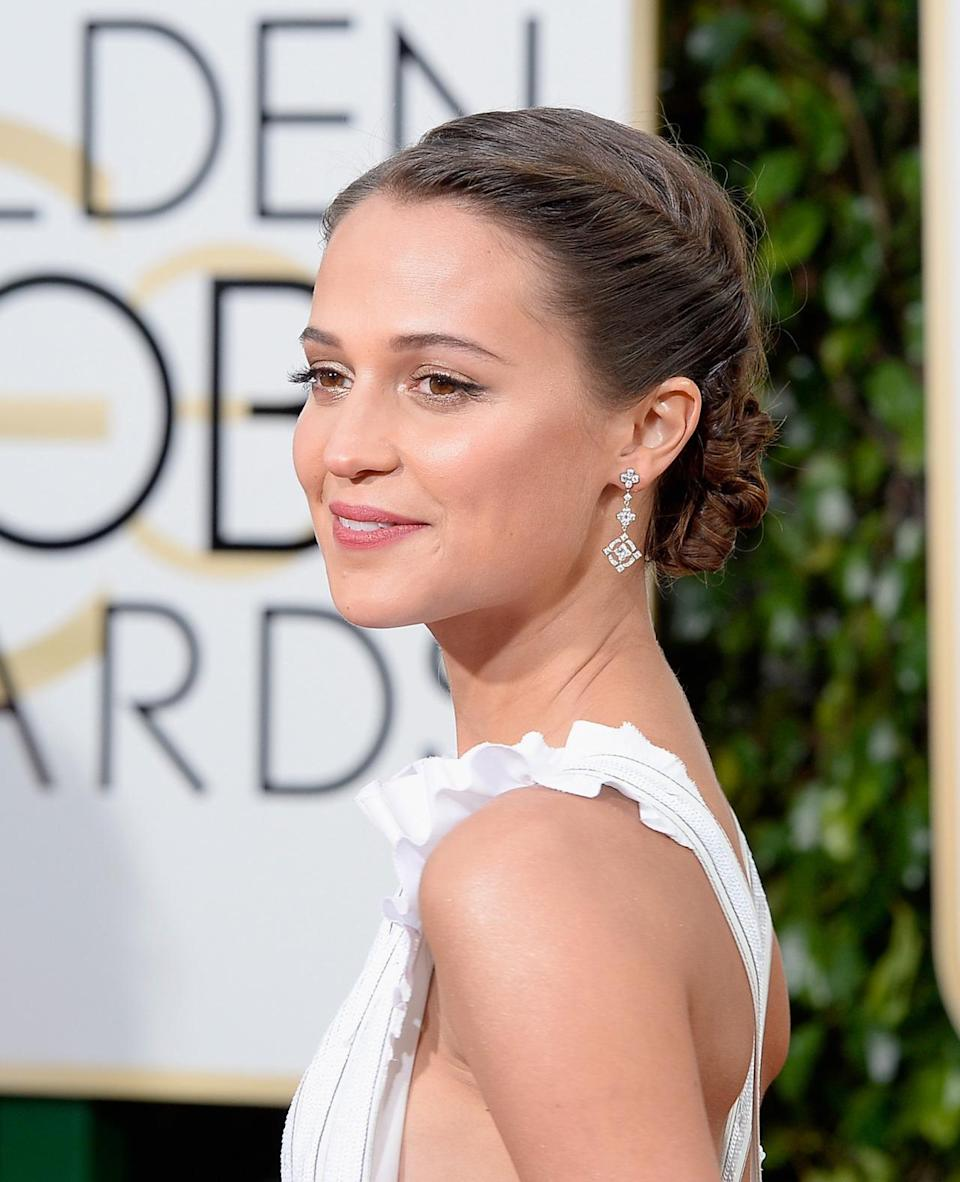 <p>Vikander was on vacation with boyfriend Michael Fassbender a few weeks ago, so maybe her tan is real. <i>(Photo: Getty Images)</i></p>