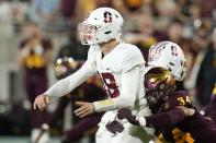 Arizona State linebacker Kyle Soelle (34) hits Tanner McKee, left, as he releases the ball during the second half of an NCAA college football game Friday, Oct. 8, 2021, in Tempe, Ariz. (AP Photo/Ross D. Franklin)