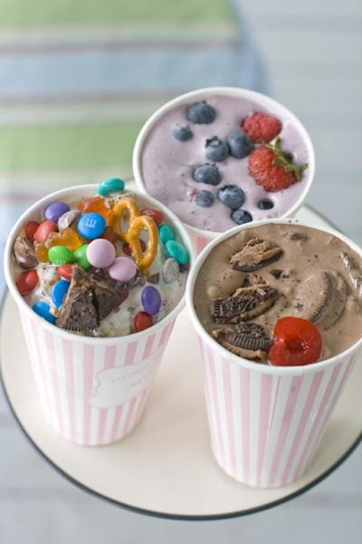 This July 22, 2013 photo shows, from top clockwise, Berry Basket, Dark Horse Cherry and Concession Stand DIY ice cream flurries in Concord, N.H. (AP Photo/Matthew Mead)