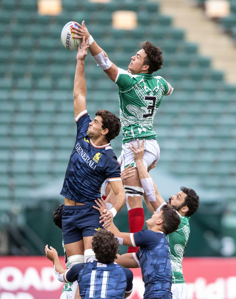 Spain's Manu Moreno, top left, and Mexico's Nicolas Falcon, top right, jump for the ball during an HSBC Canada Sevens quarterfinal rugby match in Edmonton, Alberta, Sunday, Sept. 26, 2021. (Jason Franson/The Canadian Press via AP)