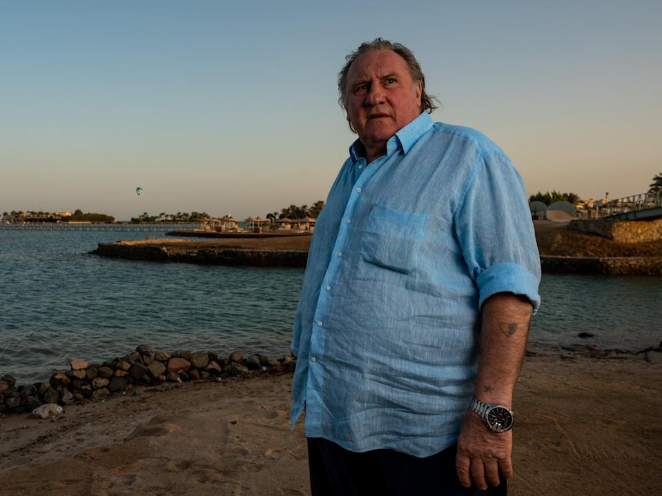 Gérard Depardieu poses at a resort a day after receiving a career achievement award, in the Egyptian Red Sea resort of el Gouna on 24 October 2020 (El Gouna Film Festival/AFP via G)