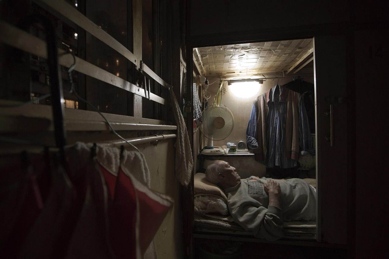"<p>Tse Chu, a retired waiter, sleeps in his ""coffin home"" in Hong Kong, March 28, 2017. In wealthy Hong Kong, there's a dark side to a housing boom, with hundreds of thousands of people forced to live in partitioned shoebox apartments, called ""coffin homes,"" and other forms of inadequate housing. As a new leader for the territory prepares to take office, housing unaffordability remains one of the Asian financial center's biggest social problems. (Photo: Kin Cheung/AP) </p>"