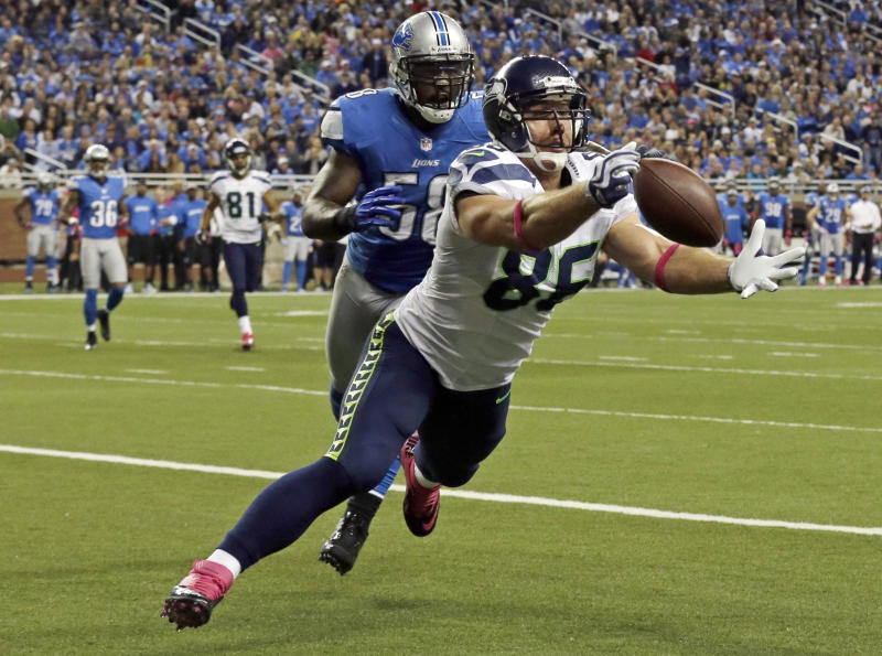 Seattle Seahawks tight end Zach Miller (86) makes a touchdown reception in the end zone against Detroit Lions linebacker Ashlee Palmer (58) in the second half of an NFL football game, Sunday, Oct. 28, 2012, in Detroit. (AP Photo/Paul Sancya )