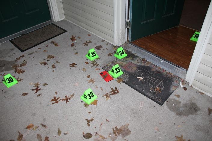 In this crime scene evidence photo released by the Louisville Metro Police Department, Louisville Police marked shell casings are seen at the front door of Breonna Taylor's apartment after she was fatally shot by police in Louisville, Ky., on March 13, 2020. The Kentucky Attorney General said in October that two long rifle shell casings were also found at the scene after the police raid that killed Taylor. (Louisville Metro Police Department via AP)