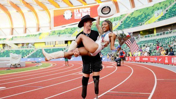PHOTO: Tara Davis celebrates with boyfriend and Paralympian Hunter Woodhall at the 2021 U.S. Olympic Track & Field Team Trials at Hayward Field, June 26, 2021, in Eugene, Oregon. (Steph Chambers/Getty Images)