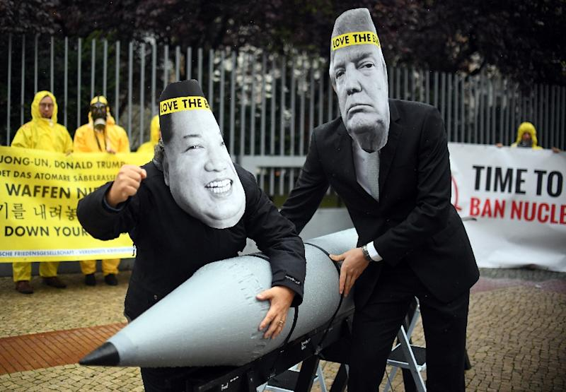 With the nuclear threat its most acute in decades, activists from the International Campaign to Abolish Nuclear Weapons (ICAN) demonstrated last month in Berlin, dressed up as US President Donald Trump and North Korea's leader Kim Jong-Un (AFP Photo/Britta Pedersen)