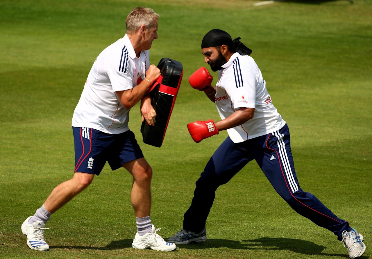BIRMINGHAM, UNITED KINGDOM - JULY 28:  Monty Panesar boxes with head coach Peter Moores during the England nets session at Edgbaston ahead of the 3rd Npower Test match between England and South Africa on July 28, 2008 in Birmingham, England.  (Photo by Richard Heathcote/Getty Images)