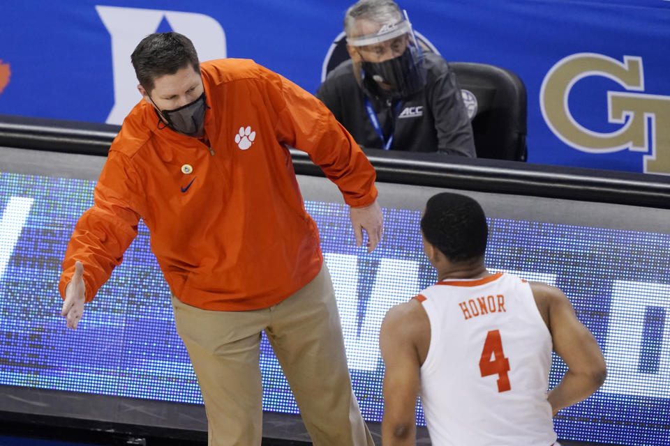 Clemson head coach Brad Brownwell greets guard Nick Honor (4) during the second half of an NCAA college basketball game in the second round of the Atlantic Coast Conference tournament in Greensboro, N.C., Wednesday, March 10, 2021. (AP Photo/Gerry Broome)