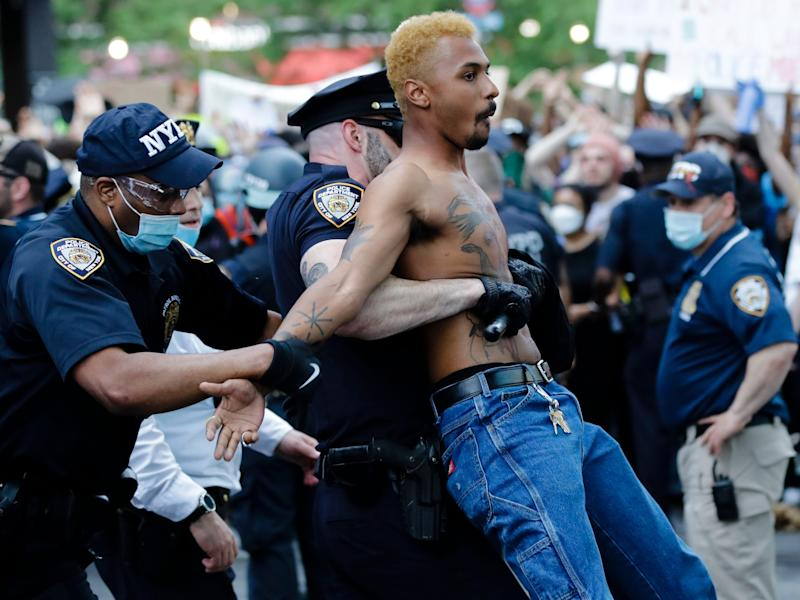 A protester is arrested during a rally at the Barclays Center over the death of George Floyd, a black man who was in police custody in Minneapolis Friday, May 29, 2020, in the Brooklyn borough of New York. (AP Photo:Frank Franklin II)