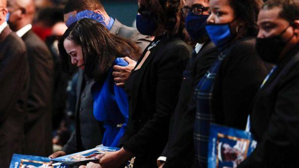 PHOTO: Karissa Hill, daughter of Andre Hill, is comforted by family as she weeps while her father's casket is closed at the start of his funeral service, Jan. 5, 2021, at First Church of God, in Columbus, Ohio. (Columbus Dispatch via USA Today Network)