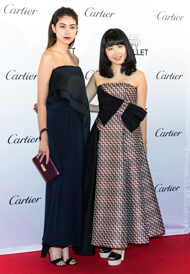 <p>Actress/model Mori, wearing a simple black strapless gown, posed next to the Adeam designer who wore a kitschy zig-zag print dress with platform shoes. (Getty Images) </p>