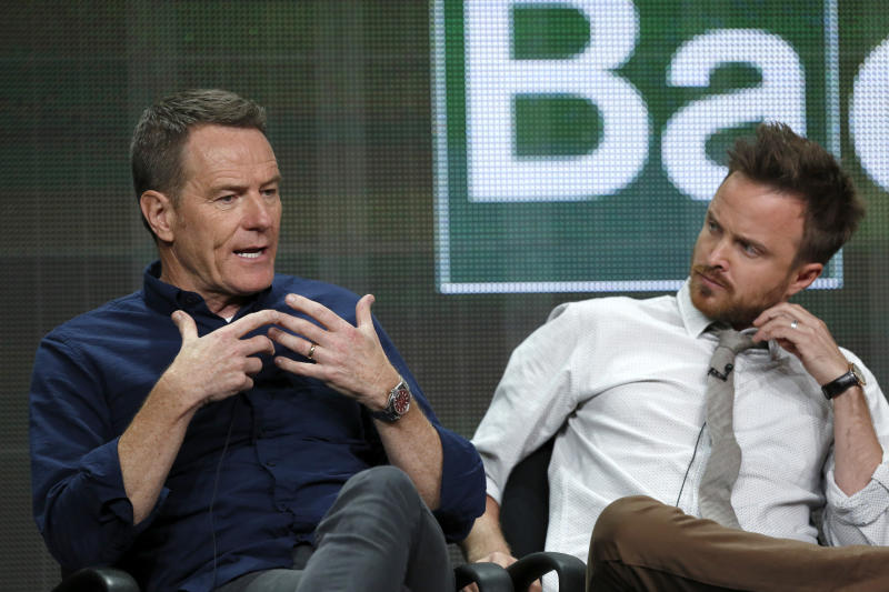 """Cast member Bryan Cranston (L) speaks next to co-star Aaron Paul at a panel for the television series """"Breaking Bad"""" during the AMC portion of the Television Critics Association Summer press tour in Beverly Hills, California July 26, 2013. REUTERS/Mario Anzuoni (UNITED STATES - Tags: ENTERTAINMENT)"""