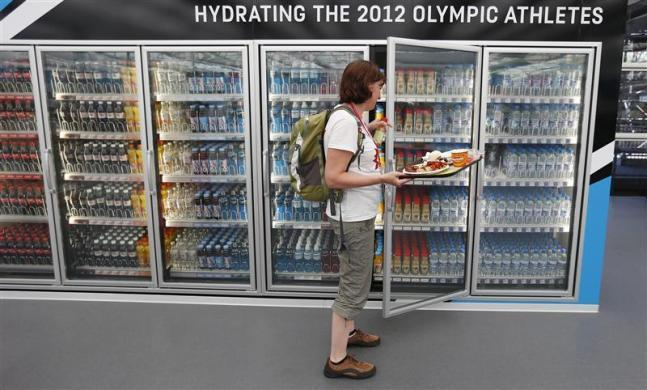 A Canadian team athlete takes a drink from a refrigerator in the main dining hall inside the London 2012 Olympic Games Village in Stratford, east London July 24, 2012.