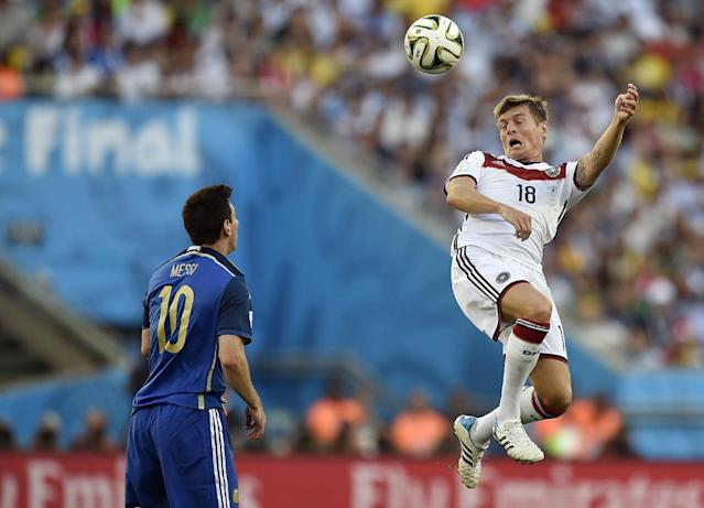 Germany's Toni Kroos (18) rises above Argentina's Lionel Messi (10) to head the ball during the World Cup final soccer match between Germany and Argentina at the Maracana Stadium in Rio de Janeiro, Brazil, Sunday, July 13, 2014. (AP Photo/Martin Meissner)