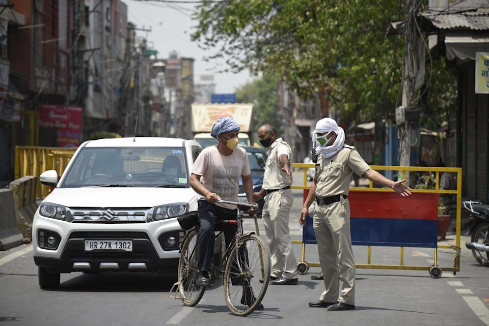 GURUGRAM, INDIA - MAY 5: Police personnel screen commuters for documents during a lockdown imposed to curb the spread of coronavirus disease, at Sohna Chowk near Sadar Bazar, on May 5, 2021 in Gurugram, India. (Photo by Parveen Kumar/Hindustan Times via Getty Images)