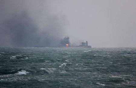 Smoke is seen from Panama-registered Sanchi tanker carrying Iranian oil that caught ablaze after it collided with a Chinese freight ship in the East China Sea. China's Ministry of Transport/via REUTERS