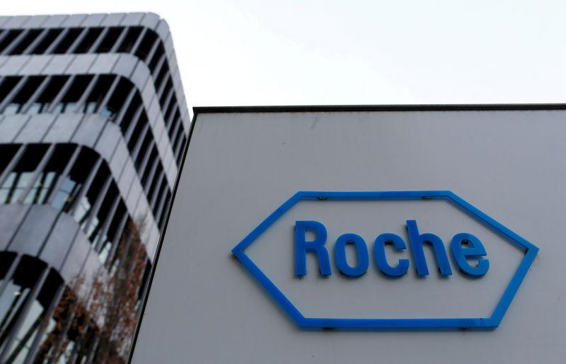FILE PHOTO: The logo of Swiss pharmaceutical company Roche is seen outside their headquarters in Basel, Switzerland.