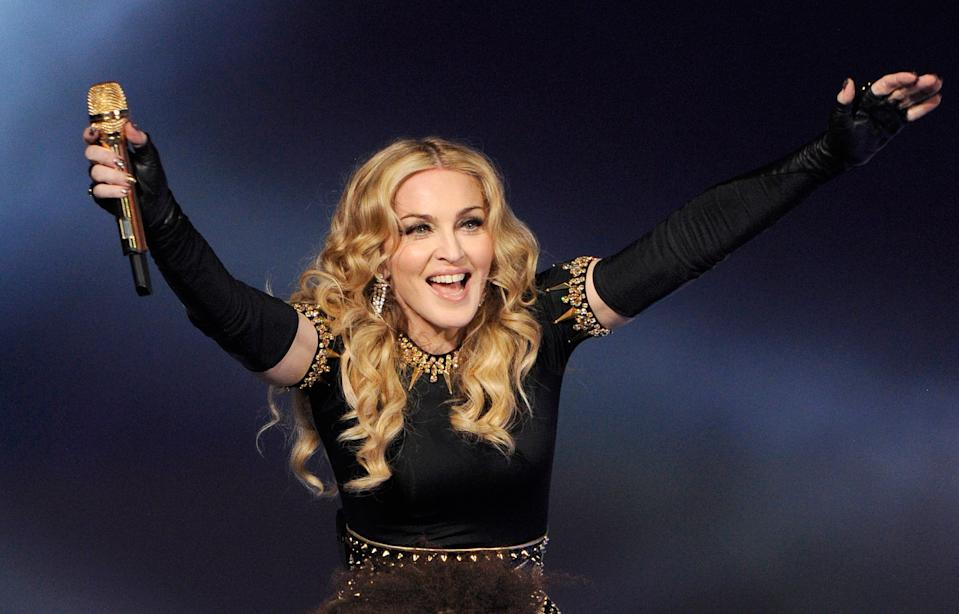 INDIANAPOLIS, IN - FEBRUARY 05:  Madonna performs during the Bridgestone Super Bowl XLVI Halftime Show at Lucas Oil Stadium on February 5, 2012 in Indianapolis, Indiana.  (Photo by Kevin Mazur/WireImage)