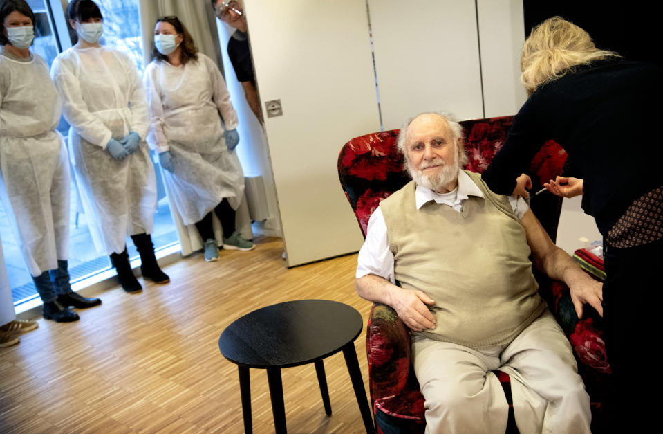 Resident Carl-Einar Joergensen receives a second dose of the Pfizer BioNTech vaccine, administered by Dr, Puk Laugen at Plejecenter Faelledgaarden, in Copenhagen, Denmark, Saturday, Jan. 23. 2021. (Nils Meilvang/Ritzau Scanpix via AP)