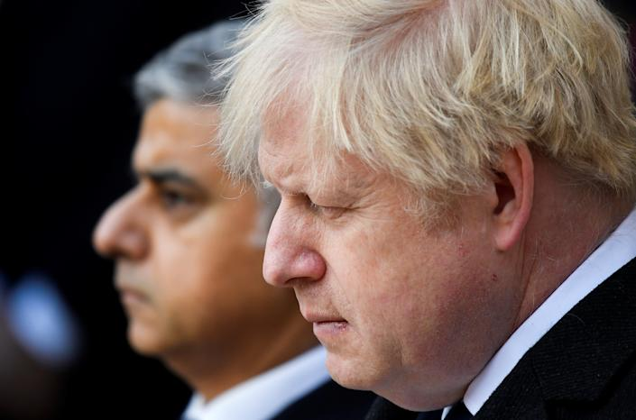 Britain's Prime Minister Boris Johnson and Mayor of London Sadiq Khan attend a vigil for victims of a fatal attack on London Bridge in London, Britain December 2, 2019.  REUTERS/Toby Melville