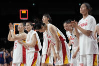 China walk off the court following their loss to Serbia in a women's basketball quarterfinal game at the 2020 Summer Olympics, Wednesday, Aug. 4, 2021, in Saitama, Japan. (AP Photo/Eric Gay)