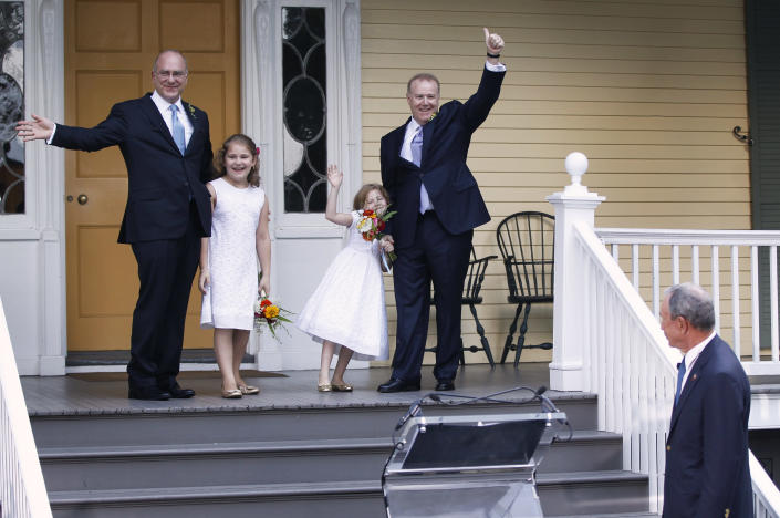 Jonathan Mintz (L), New York City's consumer affairs commissioner, and John Feinblatt (2nd R), a chief adviser to the mayor, celebrate their marriage with daughters Maeve (2nd L) and Georgia after being married by New York City Mayor Michael Bloomberg (R) at Gracie Mansion in New York July 24, 2011. Thousands of gay and lesbian New Yorkers are have been married this weekend, as the Empire State becomes the sixth in the U.S. to embrace same-sex marriage. (REUTERS/Lucas Jackson)