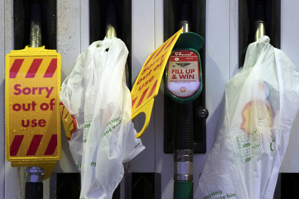 Closed pumps are seen on the forecourt of a petrol station which has run out of fuel after an outbreak of panic buying in the UK, in Manchester, England, Monday, Sept. 27, 2021. British Prime Minister Boris Johnson is said to be considering whether to call in the army to deliver fuel to petrol stations as pumps ran dry after days of panic buying. ( AP Photo/Jon Super)