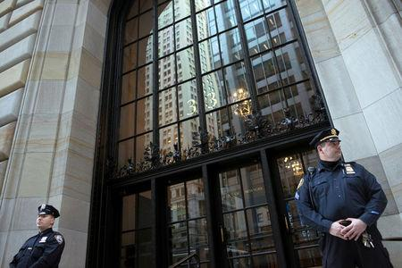 FILE PHOTO - Federal Reserve and New York City Police officers stand guard in front of the New York Federal Reserve Building in New York, October 17, 2012.   REUTERS/Keith Bedford/File Photo