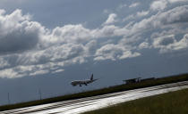 A plane carrying AstraZeneca COVID-19 vaccines arrives at the Kamuzu International Airport in Lilongwe, Malawi, Friday March 5, 2021. The country is the latest in Africa to receive vaccines in a fight against COVID-19. (AP Photo/Thoko Chikondi)