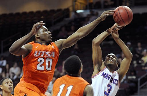 UTSA's Edrico McGregor (20) blocks a shot by UT Arlington's Jamel Outler (3) during the first half of a Western Athletic Conference tournament NCAA college basketball game, Friday, March 15, 2013 in Las Vegas. (AP Photo/David Becker)