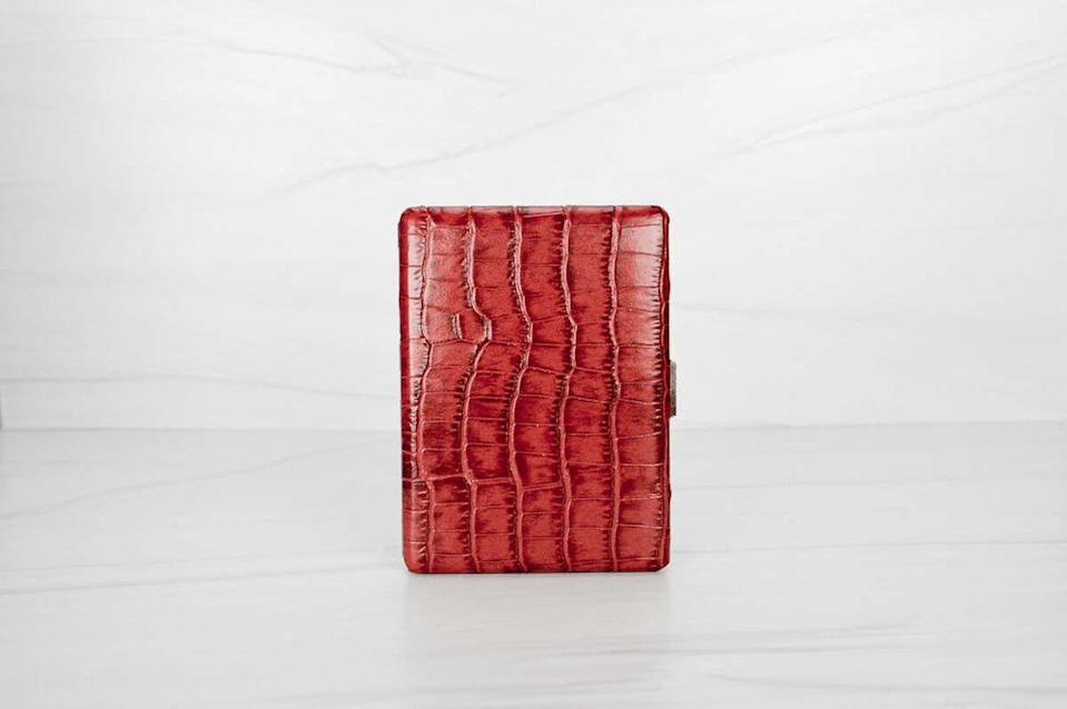 """<p><strong>House of Puff</strong></p><p>houseofpuff.com</p><p><strong>$129.00</strong></p><p><a href=""""https://houseofpuff.com/red-leather-cigarette-case-for-women"""" rel=""""nofollow noopener"""" target=""""_blank"""" data-ylk=""""slk:Buy"""" class=""""link rapid-noclick-resp"""">Buy</a></p><p>Big enough for nine pre-rolls and classy enough for a Hollywood star of the Golden Age. Tote your smokes with style and discretion in this leather case from House of Puff, a Latina-owned luxury smoking accessory brand.</p>"""