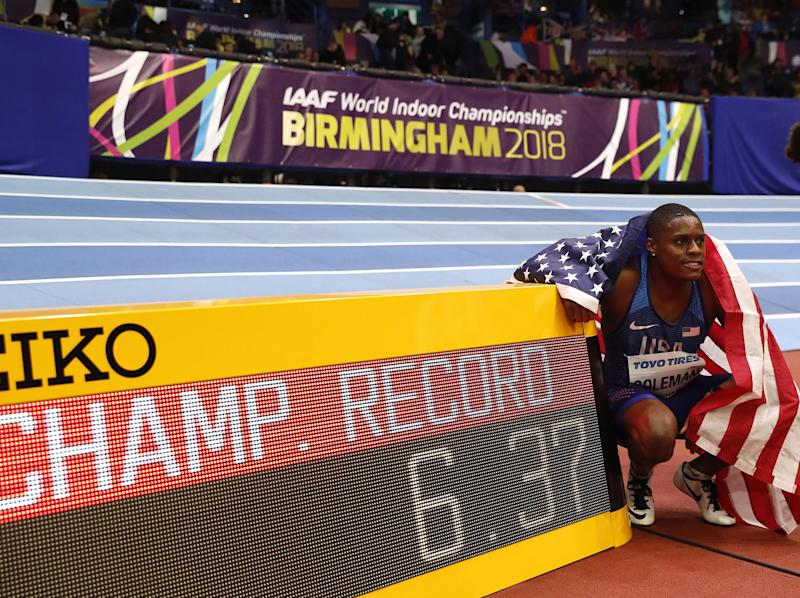 Christian Coleman poses with his winning 60m time: AFP/Getty Images