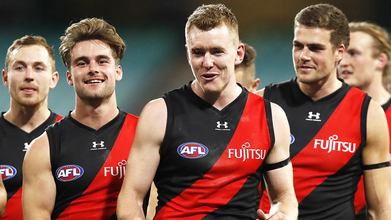 Essendon Bombers players are pictured walking off the field after their round two AFL game.