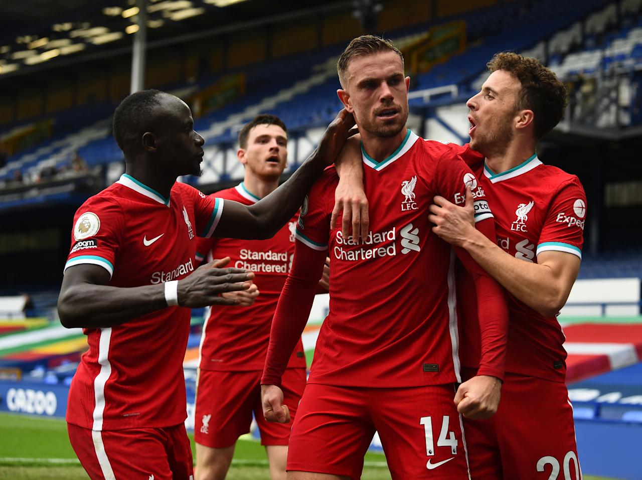 LIVERPOOL, ENGLAND - OCTOBER 17: (THE SUN OUT, THE SUN ON SUNDAY OUT ) Jordan Henderson captain of Liverpool Celebrates after scoring the third goal for Liverpool  But  then V.A.R. Cancelled his goal during the Premier League match between Everton and Liverpool at Goodison Park on October 17, 2020 in Liverpool, England. Sporting stadiums around the UK remain under strict restrictions due to the Coronavirus Pandemic as Government social distancing laws prohibit fans inside venues resulting in games being played behind closed doors. (Photo by Andrew Powell/Liverpool FC via Getty Images)