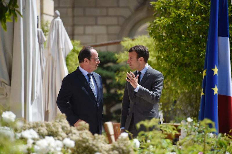 """French President Francois Hollande (L), seen with now-presidential candidate Emmanuel Macron in 2015, said of possible campaign hacks, """"We knew that there were these risks during the presidential campaign because it happened elsewhere"""""""