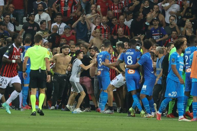 The match between Nice and Marseille was halted in the 75th minute as bottles were thrown and fans invaded the pitch
