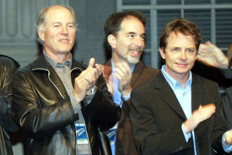 Frank Marshall and Michael J Fox at the launch party of the 'Back to the Future' DVD in 2002 - Credit: Getty Images