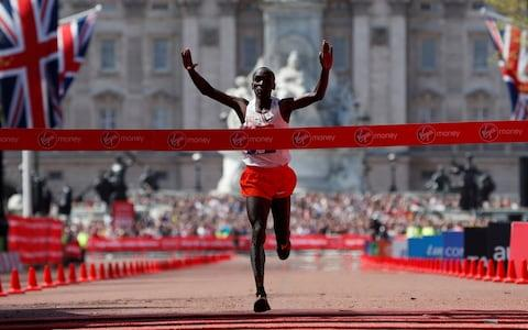 Eliud Kipchoge crosses the finish line to win - Credit: REUTERS